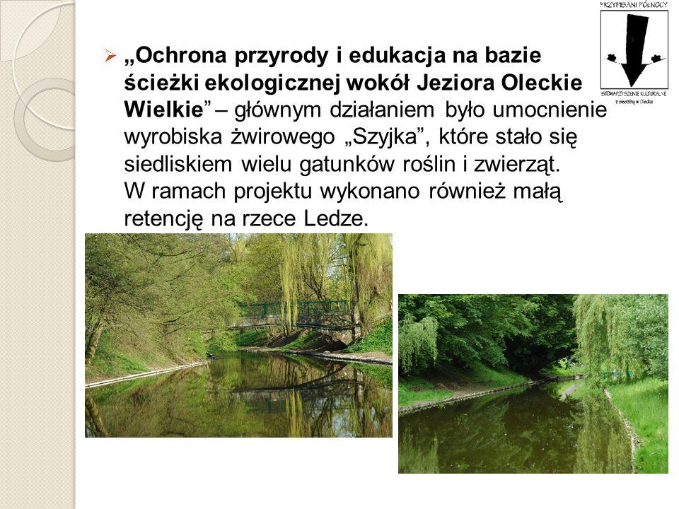 """""""Ochrona przyrody i edukacja na bazie ścieżki ekologicznej wokół Jeziora Oleckie Wielkie – głównym działaniem było umocnienie wyrobiska żwirowego """"Szyjka , które stało się siedliskiem wielu gatunków roślin i zwierząt."""