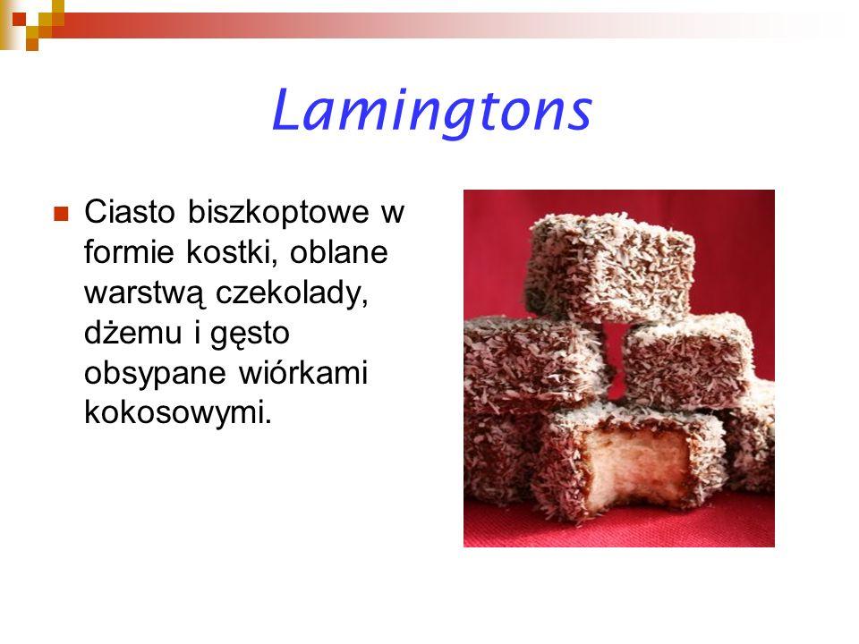 Lamingtons Ciasto biszkoptowe w formie kostki, oblane warstwą czekolady, dżemu i gęsto obsypane wiórkami kokosowymi.