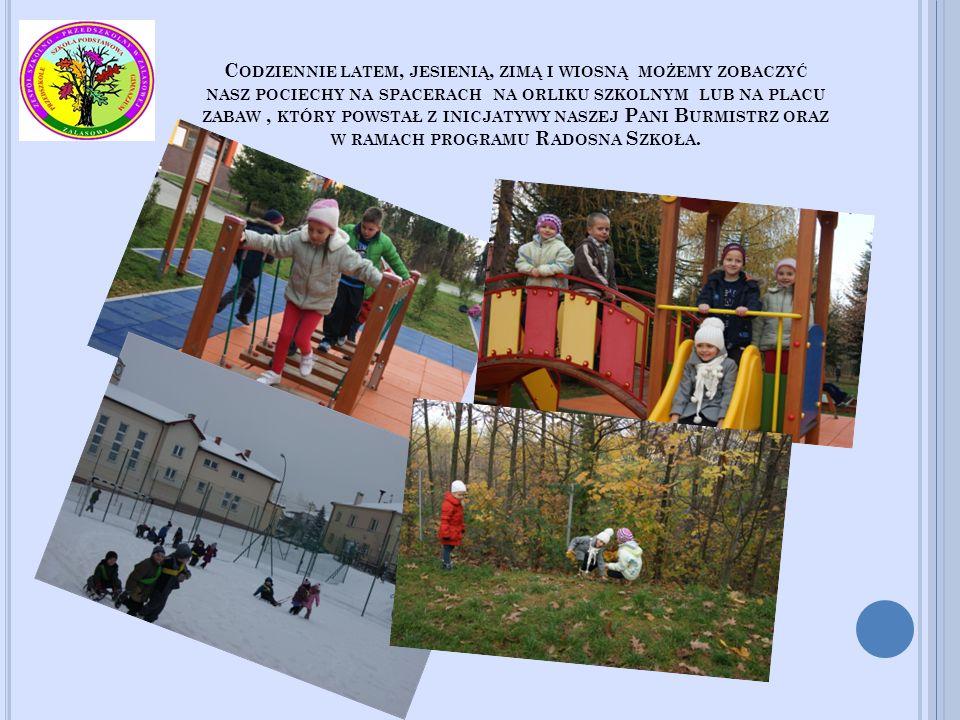 Codziennie latem, jesienią, zimą i wiosną możemy zobaczyć nasz pociechy na spacerach na orliku szkolnym lub na placu zabaw , który powstał z inicjatywy naszej Pani Burmistrz oraz w ramach programu Radosna Szkoła.
