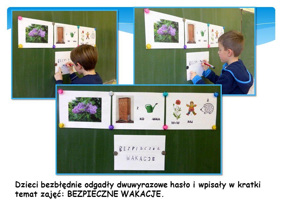 Dzieci bezbłędnie odgadły dwuwyrazowe hasło i wpisały w kratki temat zajęć: BEZPIECZNE WAKACJE.