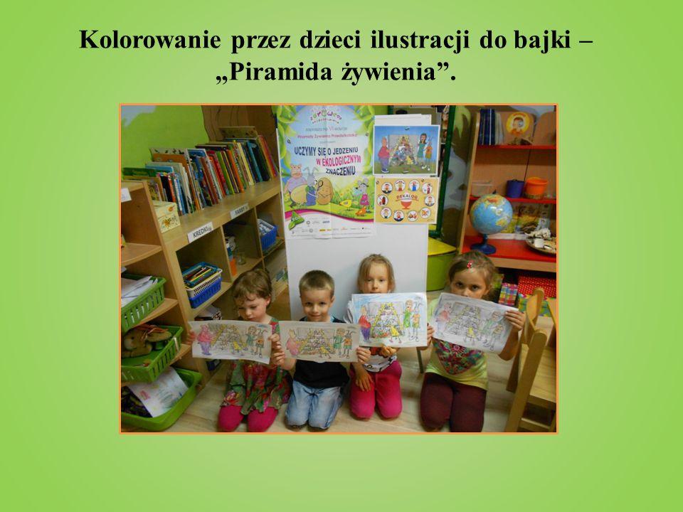 """Kolorowanie przez dzieci ilustracji do bajki – """"Piramida żywienia ."""