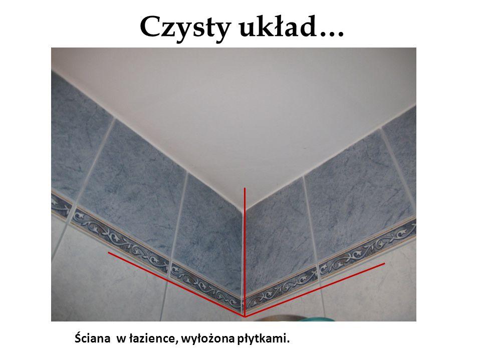 Czysty układ… Ściana w łazience, wyłożona płytkami.