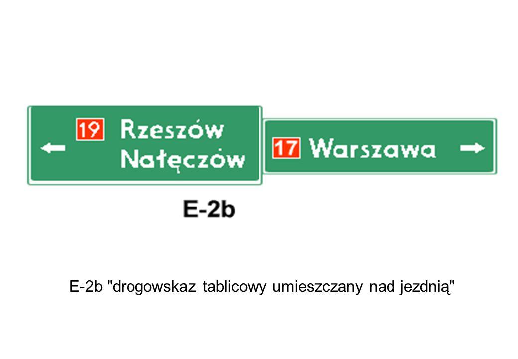 E-2b drogowskaz tablicowy umieszczany nad jezdnią