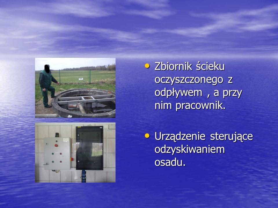 Zbiornik ścieku oczyszczonego z odpływem , a przy nim pracownik.