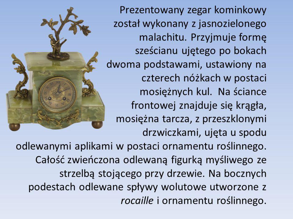 Prezentowany zegar kominkowy został wykonany z jasnozielonego malachitu.