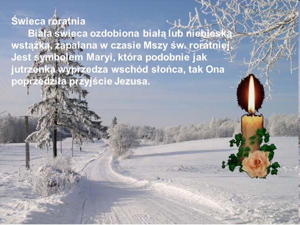 Świeca roratnia Biała świeca ozdobiona białą lub niebieską wstążką, zapalana w czasie Mszy św.