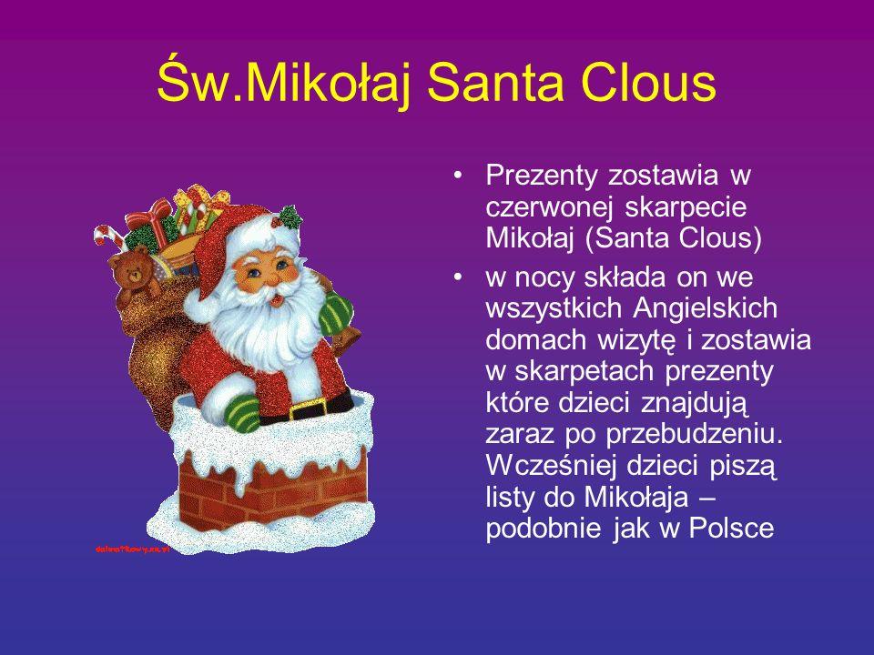 Św.Mikołaj Santa Clous Prezenty zostawia w czerwonej skarpecie Mikołaj (Santa Clous)