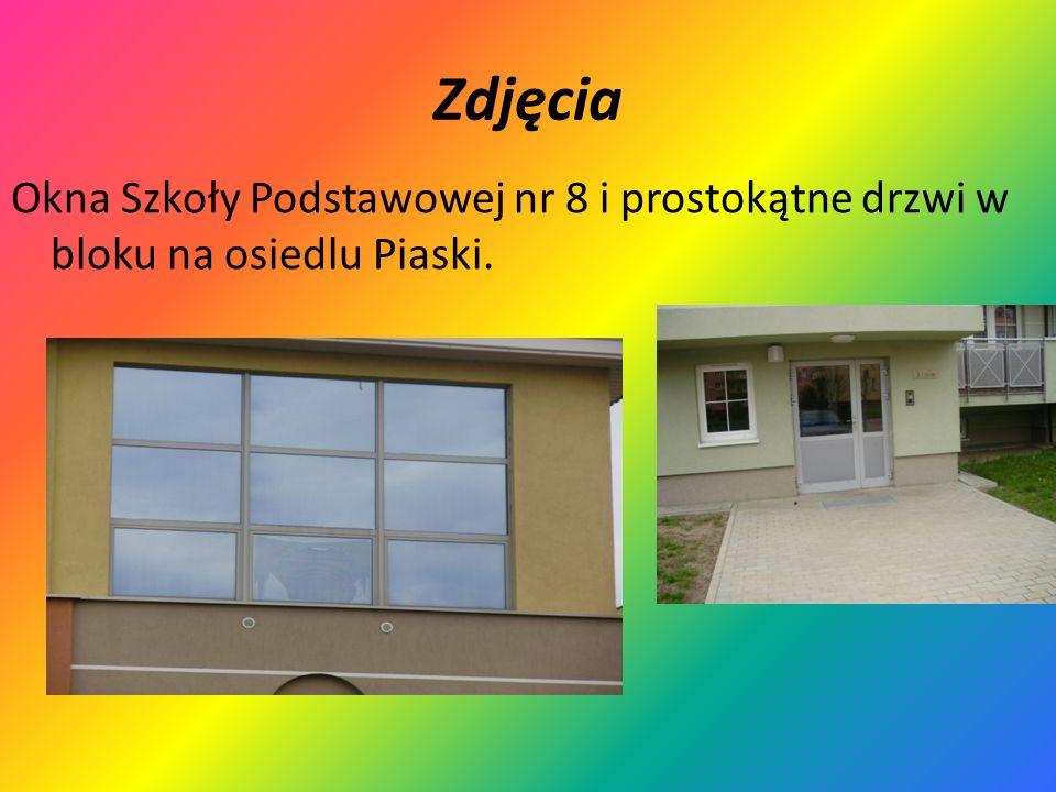 Zdjęcia Okna Szkoły Podstawowej nr 8 i prostokątne drzwi w bloku na osiedlu Piaski.