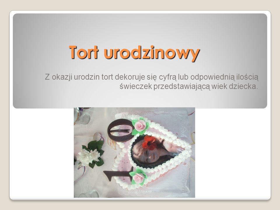 Tort urodzinowy Z okazji urodzin tort dekoruje się cyfrą lub odpowiednią ilością świeczek przedstawiającą wiek dziecka.