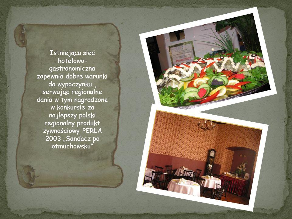 """Istniejąca sieć hotelowo- gastronomiczna zapewnia dobre warunki do wypoczynku , serwując regionalne dania w tym nagrodzone w konkursie za najlepszy polski regionalny produkt żywnościowy PERŁA 2003 """"Sandacz po otmuchowsku"""