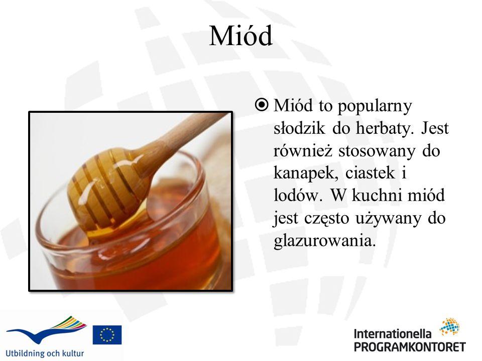 Miód Miód to popularny słodzik do herbaty. Jest również stosowany do kanapek, ciastek i lodów.
