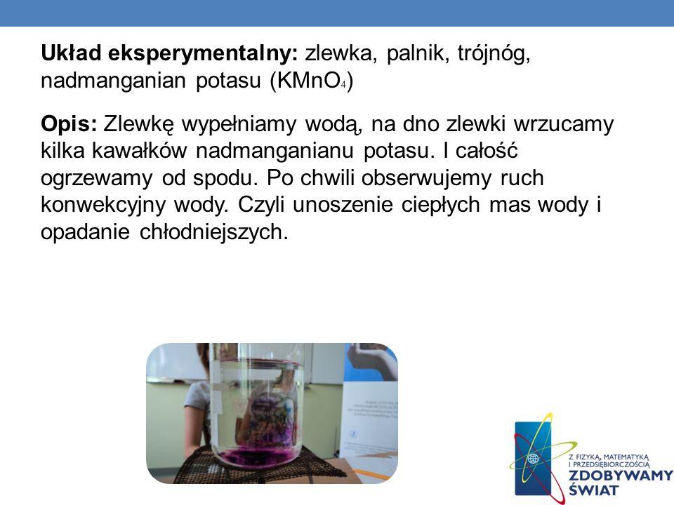 Układ eksperymentalny: zlewka, palnik, trójnóg, nadmanganian potasu (KMnO4) Opis: Zlewkę wypełniamy wodą, na dno zlewki wrzucamy kilka kawałków nadmanganianu potasu.