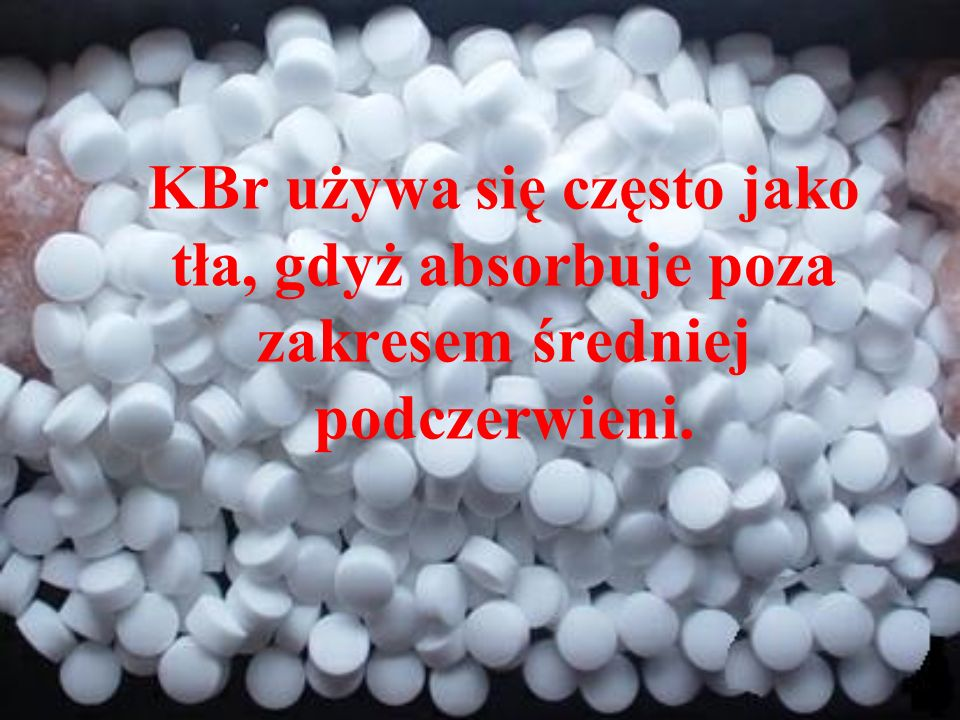 KBr używa się często jako tła, gdyż absorbuje poza zakresem średniej podczerwieni.