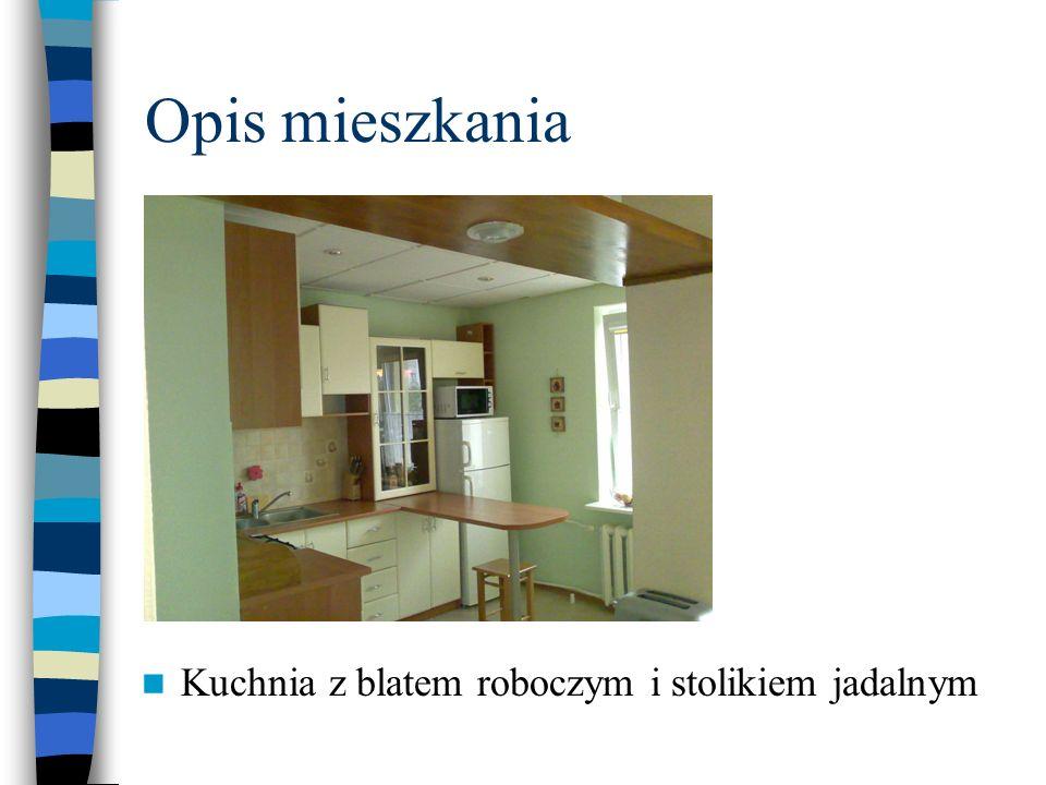 Opis mieszkania Kuchnia z blatem roboczym i stolikiem jadalnym
