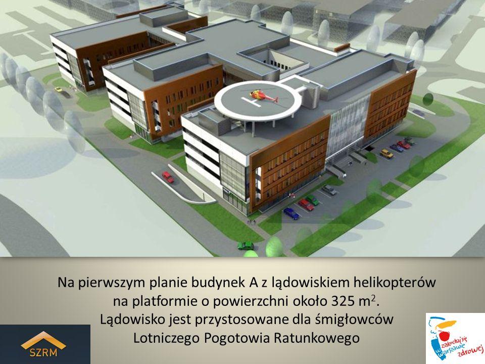 Na pierwszym planie budynek A z lądowiskiem helikopterów na platformie o powierzchni około 325 m2.