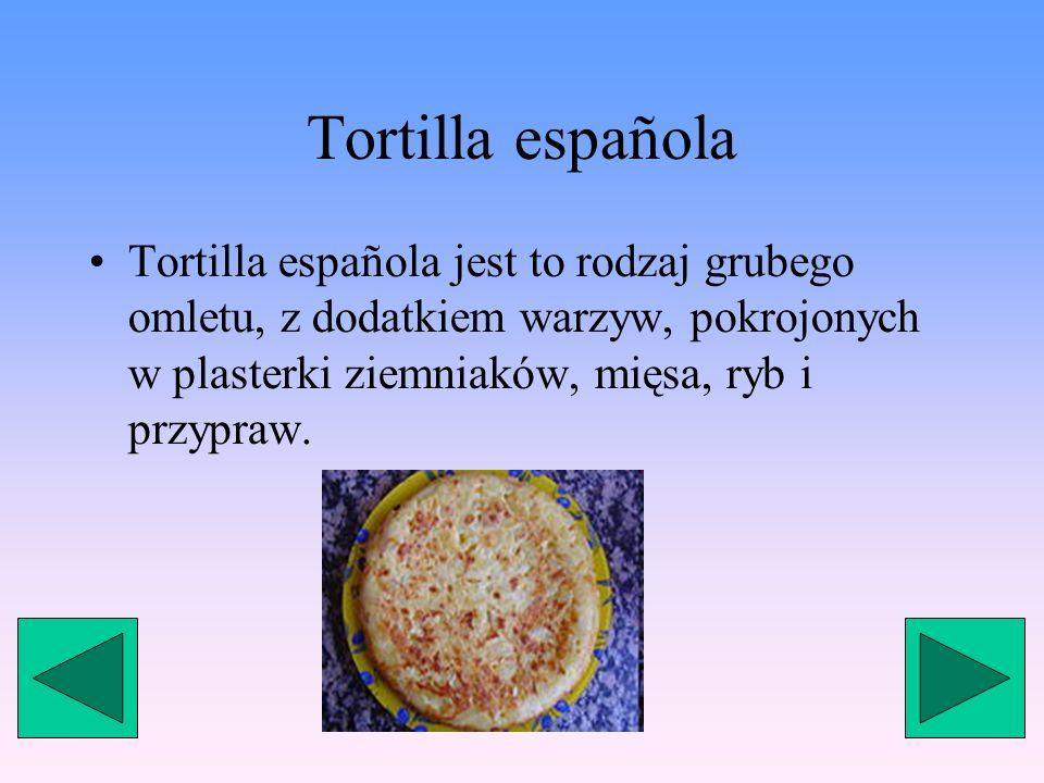 Tortilla española Tortilla española jest to rodzaj grubego omletu, z dodatkiem warzyw, pokrojonych w plasterki ziemniaków, mięsa, ryb i przypraw.