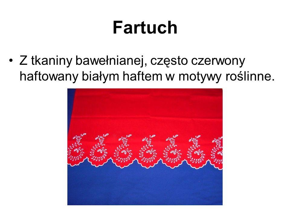 Fartuch Z tkaniny bawełnianej, często czerwony haftowany białym haftem w motywy roślinne.