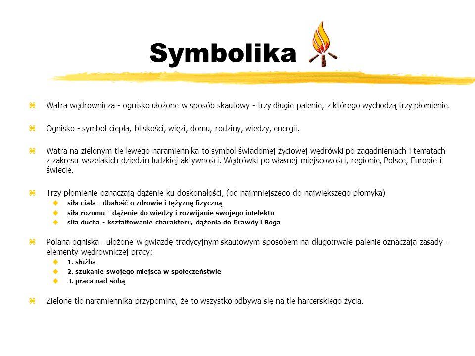 Symbolika Watra wędrownicza - ognisko ułożone w sposób skautowy - trzy długie palenie, z którego wychodzą trzy płomienie.