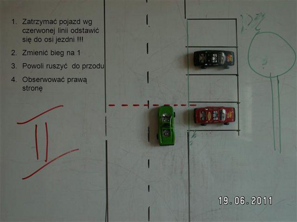 Zatrzymać pojazd wg czerwonej linii odstawić się do osi jezdni !!!