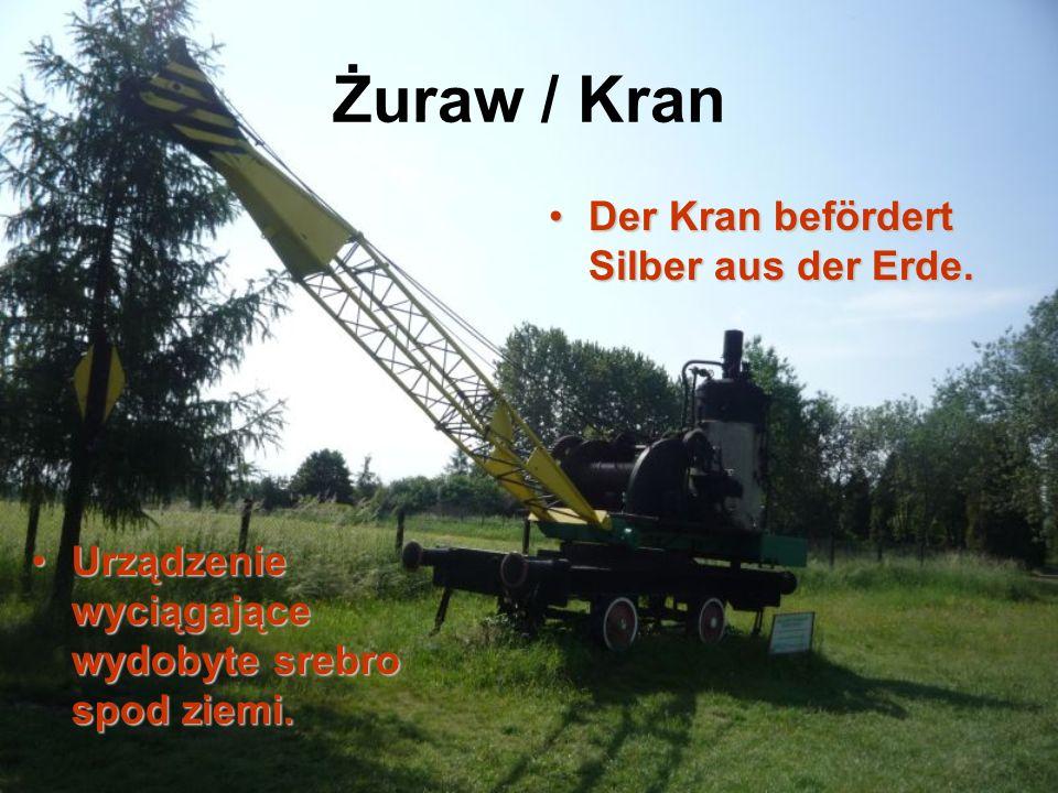 Żuraw / Kran Der Kran befördert Silber aus der Erde.