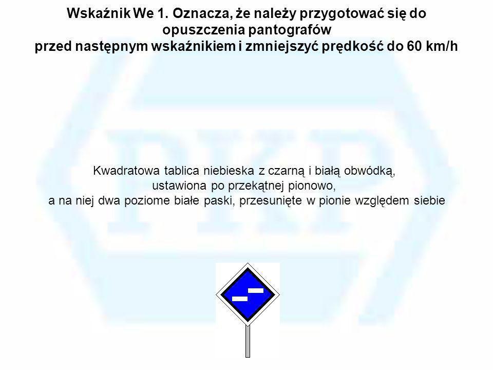 Kwadratowa tablica niebieska z czarną i białą obwódką,