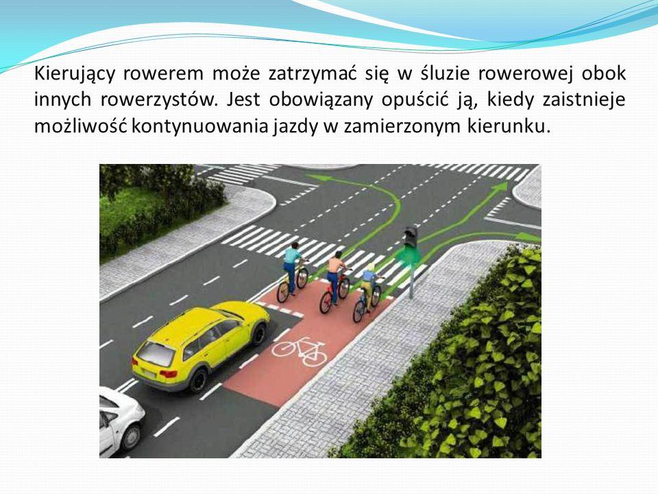 Kierujący rowerem może zatrzymać się w śluzie rowerowej obok innych rowerzystów.