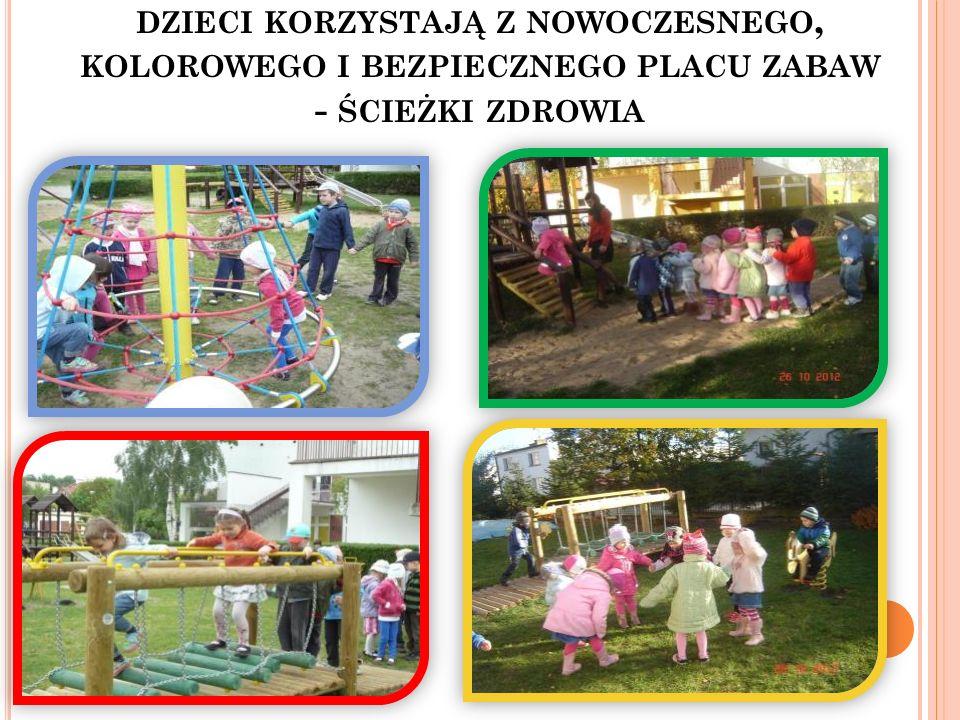 dzieci korzystają z nowoczesnego, kolorowego i bezpiecznego placu zabaw - ścieżki zdrowia