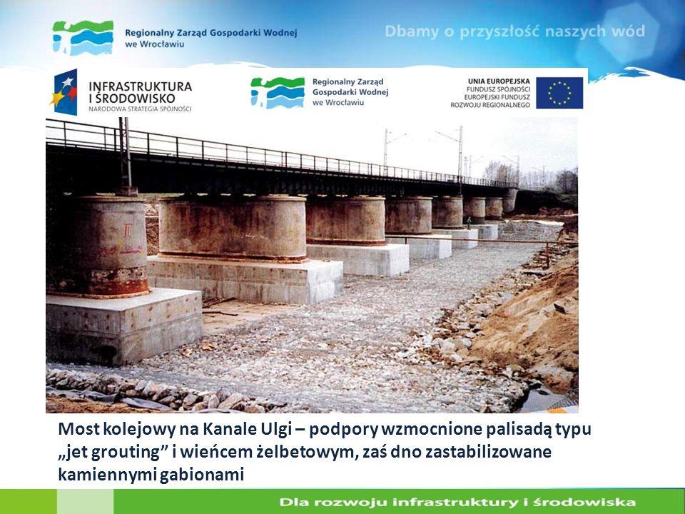 """Most kolejowy na Kanale Ulgi – podpory wzmocnione palisadą typu """"jet grouting i wieńcem żelbetowym, zaś dno zastabilizowane kamiennymi gabionami"""