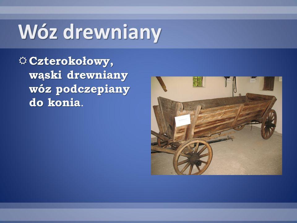 Wóz drewniany Czterokołowy, wąski drewniany wóz podczepiany do konia.