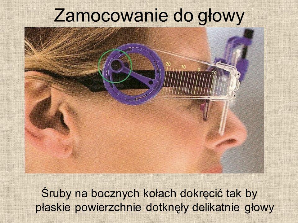 Zamocowanie do głowy Śruby na bocznych kołach dokręcić tak by płaskie powierzchnie dotknęły delikatnie głowy.