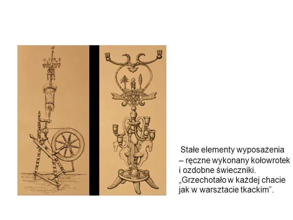 Stałe elementy wyposażenia – ręczne wykonany kołowrotek i ozdobne świeczniki.