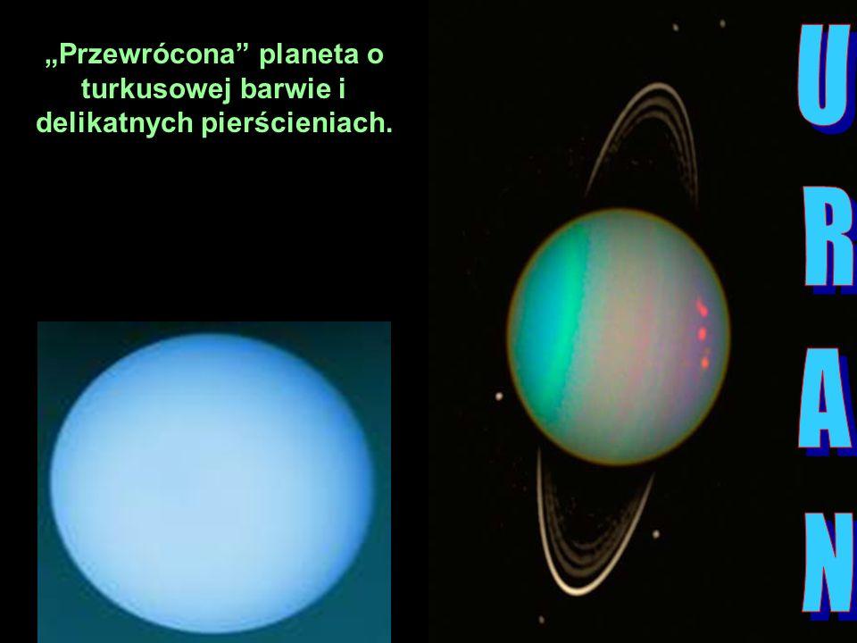 """""""Przewrócona planeta o turkusowej barwie i delikatnych pierścieniach."""
