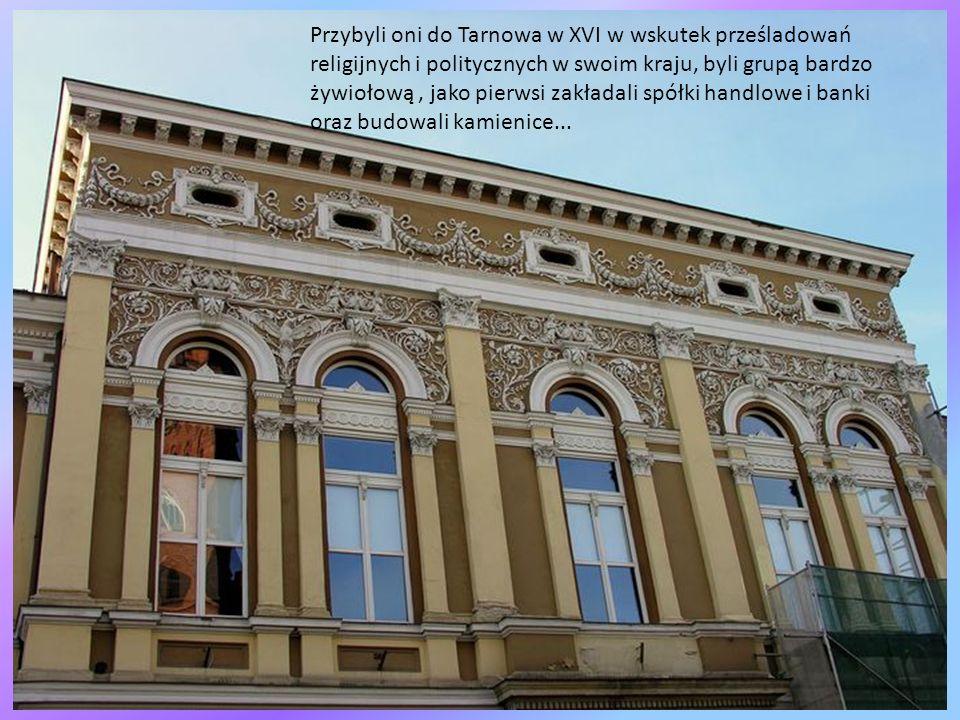 Przybyli oni do Tarnowa w XVI w wskutek prześladowań religijnych i politycznych w swoim kraju, byli grupą bardzo żywiołową , jako pierwsi zakładali spółki handlowe i banki oraz budowali kamienice...
