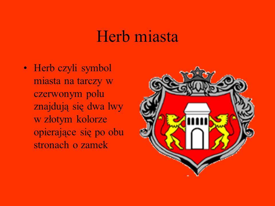 Herb miasta Herb czyli symbol miasta na tarczy w czerwonym polu znajdują się dwa lwy w złotym kolorze opierające się po obu stronach o zamek.