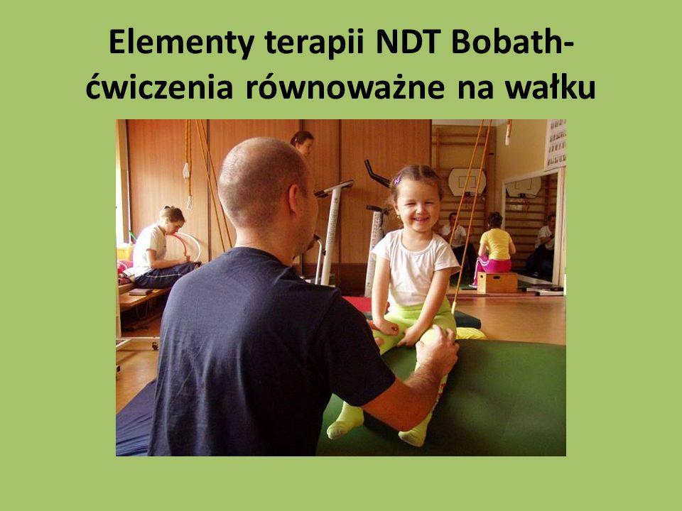 Elementy terapii NDT Bobath-ćwiczenia równoważne na wałku