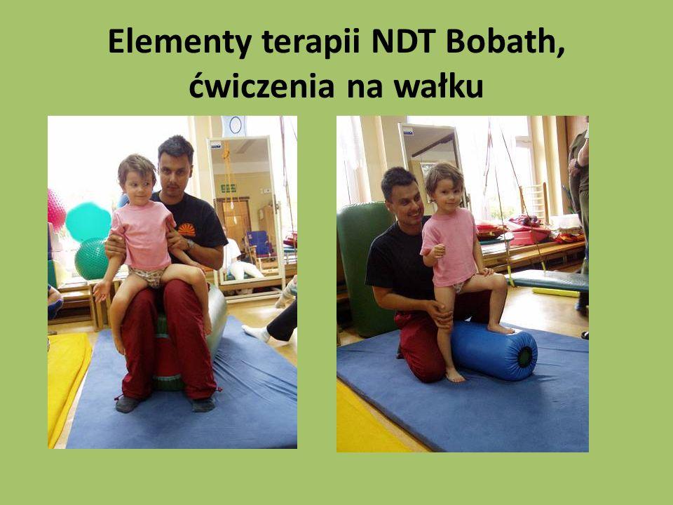 Elementy terapii NDT Bobath, ćwiczenia na wałku