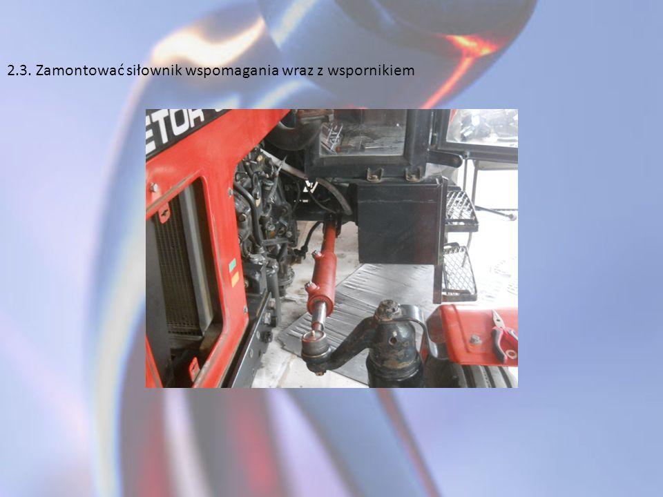 2.3. Zamontować siłownik wspomagania wraz z wspornikiem