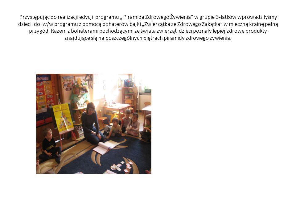 """Przystępując do realizacji edycji programu """" Piramida Zdrowego Żywienia w grupie 3-latków wprowadziłyśmy dzieci do w/w programu z pomocą bohaterów bajki """"Zwierzątka ze Zdrowego Zakątka w mleczną krainę pełną przygód."""