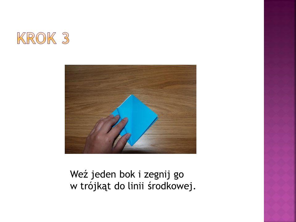 Krok 3 Weź jeden bok i zegnij go w trójkąt do linii środkowej.