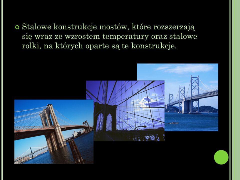 Stalowe konstrukcje mostów, które rozszerzają się wraz ze wzrostem temperatury oraz stalowe rolki, na których oparte są te konstrukcje.