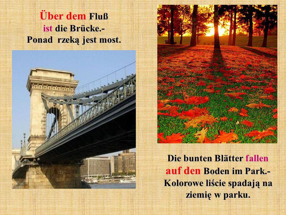 Über dem Fluß ist die Brücke.- Ponad rzeką jest most.