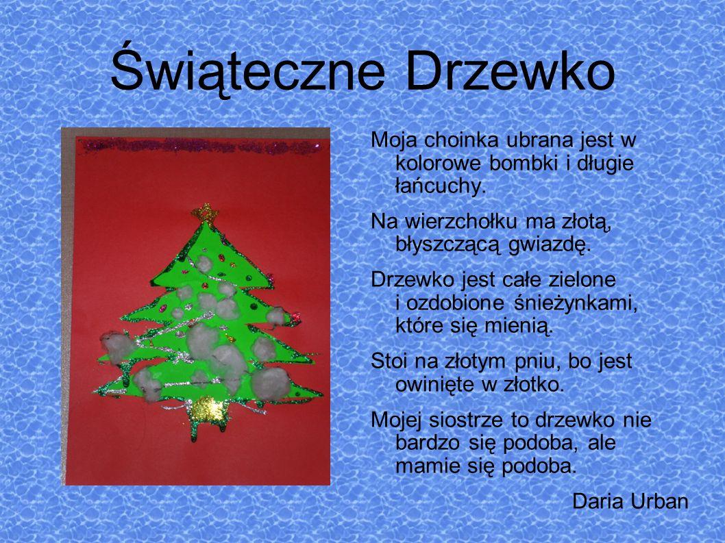 Świąteczne Drzewko Moja choinka ubrana jest w kolorowe bombki i długie łańcuchy. Na wierzchołku ma złotą, błyszczącą gwiazdę.
