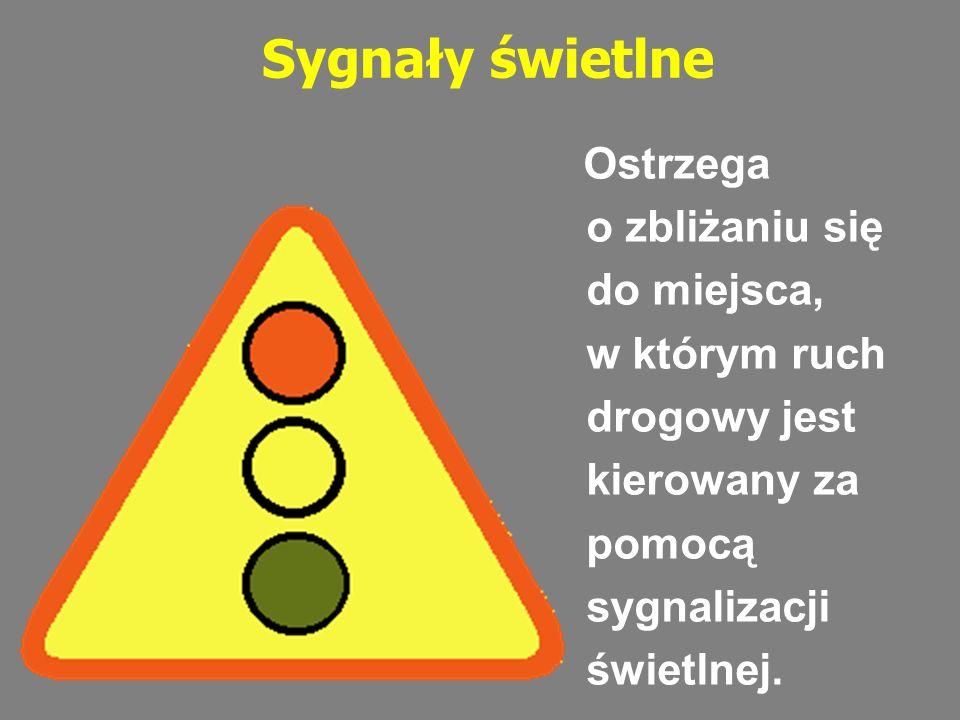 Sygnały świetlne Ostrzega o zbliżaniu się do miejsca, w którym ruch drogowy jest kierowany za pomocą sygnalizacji świetlnej.