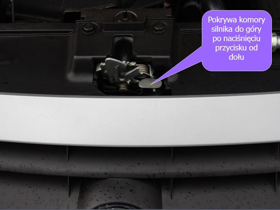 Pokrywa komory silnika do góry po naciśnięciu przycisku od dołu
