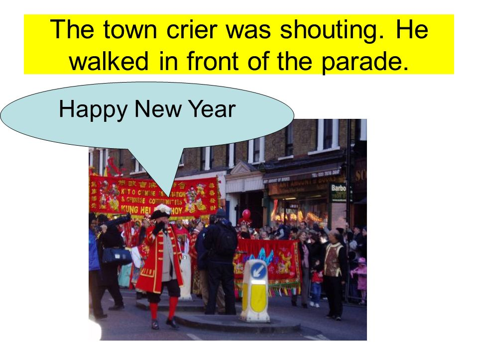 The town crier was shouting. He walked in front of the parade.